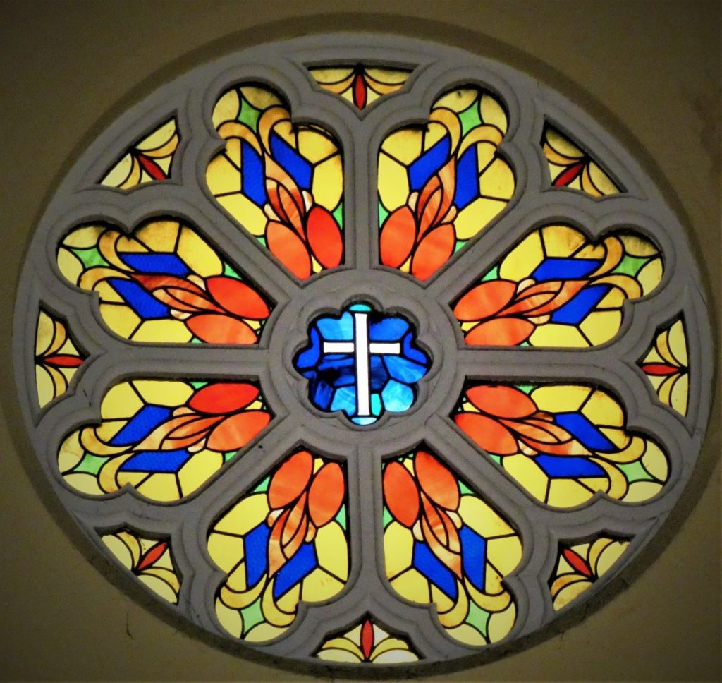 Stained glass window above the cross in Church